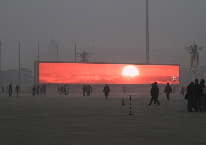 Beijing Citizens, Shrouded In Pollution, Flock To Giant Screens To View Artificial Sunrise
